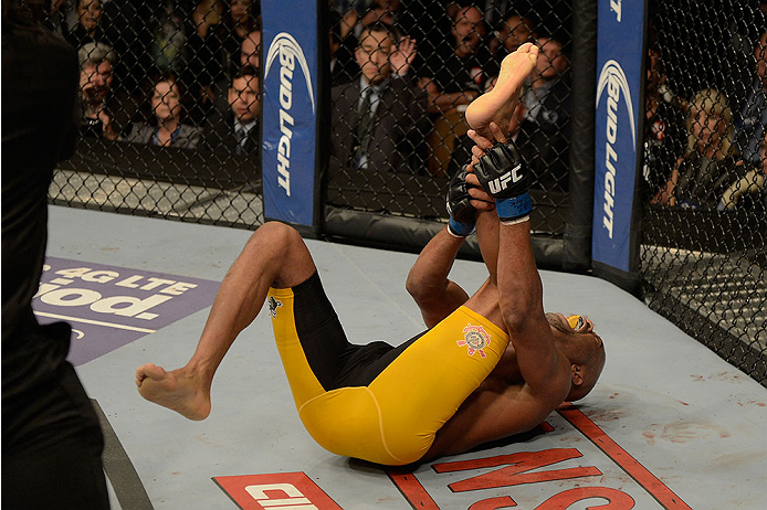 LAS VEGAS, NV - DECEMBER 28:  Anderson Silva holds his leg in pain during the UFC middleweight championship bout during the UFC 168 event at the MGM Grand Garden Arena on December 28, 2013 in Las Vegas, Nevada. (Photo by Donald Miralle/Zuffa LLC/Zuffa LLC via Getty Images) *** Local Caption *** Anderson Silva