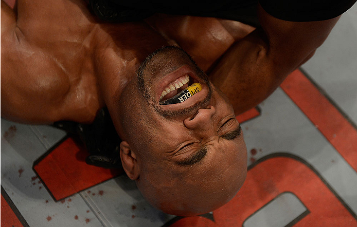 LAS VEGAS, NV - DECEMBER 28:  Anderson Silva winces in pain after his UFC middleweight championship bout during the UFC 168 event at the MGM Grand Garden Arena on December 28, 2013 in Las Vegas, Nevada. (Photo by Donald Miralle/Zuffa LLC/Zuffa LLC via Getty Images) *** Local Caption *** Anderson Silva