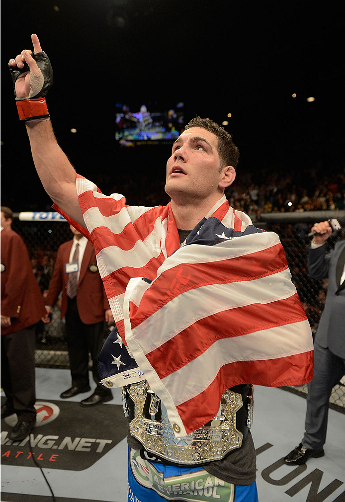 LAS VEGAS, NV - DECEMBER 28:  Chris Weidman reacts to his victory over Anderson Silva in their UFC middleweight championship bout during the UFC 168 event at the MGM Grand Garden Arena on December 28, 2013 in Las Vegas, Nevada. (Photo by Donald Miralle/Zuffa LLC/Zuffa LLC via Getty Images) *** Local Caption *** Chris Weidman