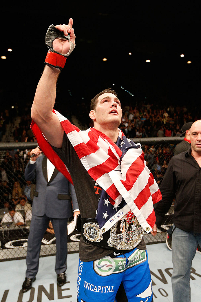 LAS VEGAS, NV - DECEMBER 28:  Chris Weidman reacts to his victory over Anderson Silva in their UFC middleweight championship bout during the UFC 168 event at the MGM Grand Garden Arena on December 28, 2013 in Las Vegas, Nevada. (Photo by Josh Hedges/Zuffa LLC/Zuffa LLC via Getty Images) *** Local Caption *** Chris Weidman