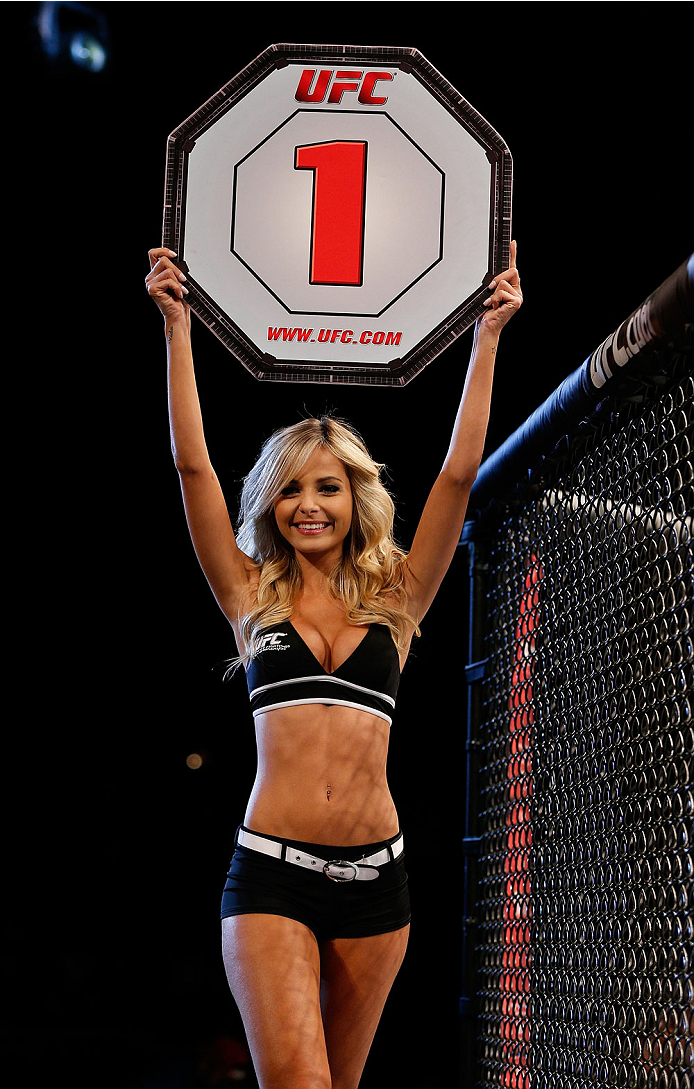 BELO HORIZONTE, BRAZIL - SEPTEMBER 04:  UFC Octagon Girl Jhenny Andrade introduces a round during the UFC on FOX Sports 1 event at Mineirinho Arena on September 4, 2013 in Belo Horizonte, Brazil. (Photo by Josh Hedges/Zuffa LLC/Zuffa LLC via Getty Images)