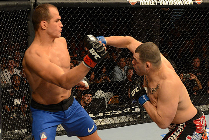 LAS VEGAS, NV - DECEMBER 29:  (R-L) Cain Velasquez punches Junior dos Santos during their heavyweight championship fight at UFC 155 on December 29, 2012 at MGM Grand Garden Arena in Las Vegas, Nevada. (Photo by Donald Miralle/Zuffa LLC/Zuffa LLC via Getty Images) *** Local Caption *** Junior dos Santos; Cain Velasquez