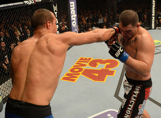 LAS VEGAS, NV - DECEMBER 29:  (L-R) Junior dos Santos punches Cain Velasquez during their heavyweight championship fight at UFC 155 on December 29, 2012 at MGM Grand Garden Arena in Las Vegas, Nevada. (Photo by Donald Miralle/Zuffa LLC/Zuffa LLC via Getty Images) *** Local Caption *** Junior dos Santos; Cain Velasquez