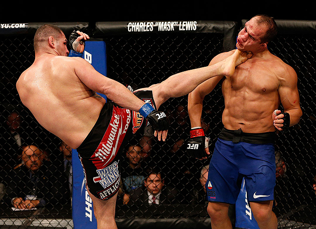 LAS VEGAS, NV - DECEMBER 29:  (L-R) Cain Velasquez kicks Junior dos Santos during their heavyweight championship fight at UFC 155 on December 29, 2012 at MGM Grand Garden Arena in Las Vegas, Nevada. (Photo by Josh Hedges/Zuffa LLC/Zuffa LLC via Getty Images) *** Local Caption *** Junior dos Santos; Cain Velasquez