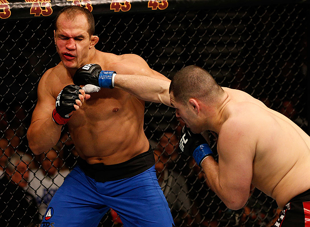 LAS VEGAS, NV - DECEMBER 29:  (R-L) Cain Velasquez punches Junior dos Santos during their heavyweight championship fight at UFC 155 on December 29, 2012 at MGM Grand Garden Arena in Las Vegas, Nevada. (Photo by Josh Hedges/Zuffa LLC/Zuffa LLC via Getty Images) *** Local Caption *** Junior dos Santos; Cain Velasquez