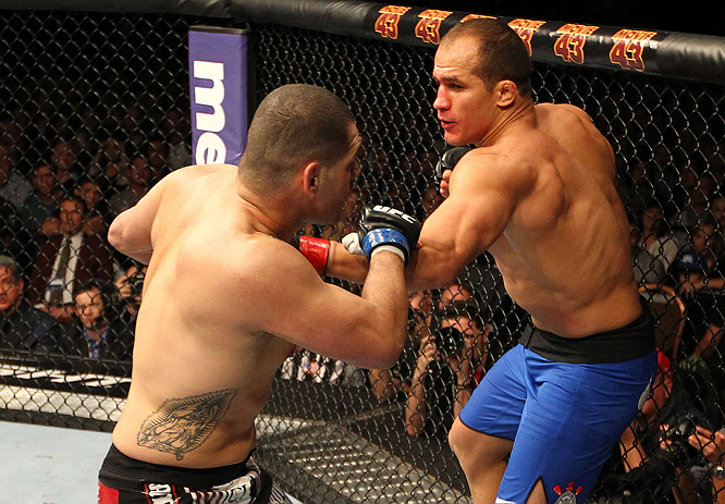 LAS VEGAS, NV - DECEMBER 29:  (L-R) Junior dos Santos punches Cain Velasquez during their heavyweight championship fight at UFC 155 on December 29, 2012 at MGM Grand Garden Arena in Las Vegas, Nevada. (Photo by Josh Hedges/Zuffa LLC/Zuffa LLC via Getty Images) *** Local Caption *** Junior dos Santos; Cain Velasquez