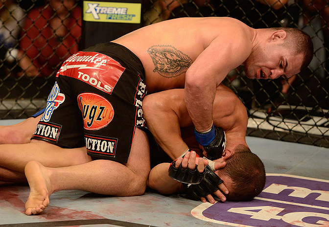 LAS VEGAS, NV - DECEMBER 29:  Cain Velasquez (top) punches Junior dos Santos during their heavyweight championship fight at UFC 155 on December 29, 2012 at MGM Grand Garden Arena in Las Vegas, Nevada. (Photo by Donald Miralle/Zuffa LLC/Zuffa LLC via Getty Images) *** Local Caption *** Junior dos Santos; Cain Velasquez