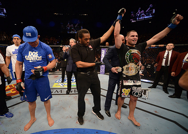 LAS VEGAS, NV - DECEMBER 29:  Cain Velasquez (right) is named the winner over Junior dos Santos (left) after their heavyweight championship fight at UFC 155 on December 29, 2012 at MGM Grand Garden Arena in Las Vegas, Nevada. (Photo by Donald Miralle/Zuffa LLC/Zuffa LLC via Getty Images) *** Local Caption *** Junior dos Santos; Cain Velasquez