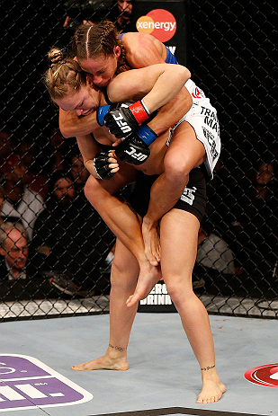 ANAHEIM, CA - FEBRUARY 23:  Liz Carmouche (top) attempts to submit Ronda Rousey in their women's bantamweight title fight during UFC 157 at Honda Center on February 23, 2013 in Anaheim, California.  (Photo by Josh Hedges/Zuffa LLC/Zuffa LLC via Getty Images) *** Local Caption *** Ronda Rousey; Liz Carmouche