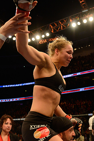 ANAHEIM, CA - FEBRUARY 23:  Ronda Rousey celebrates her victory over Liz Carmouche in their women's bantamweight title fight during UFC 157 at Honda Center on February 23, 2013 in Anaheim, California.  (Photo by Donald Miralle/Zuffa LLC/Zuffa LLC via Getty Images) *** Local Caption *** Ronda Rousey; Liz Carmouche