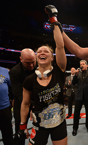 ANAHEIM, CA - FEBRUARY 23:  UFC President Dana White (rear) puts the UFC women's bantamweight title belt around Ronda Rousey after women's bantamweight title fight during UFC 157 at Honda Center on February 23, 2013 in Anaheim, California.  (Photo by Donald Miralle/Zuffa LLC/Zuffa LLC via Getty Images) *** Local Caption *** Ronda Rousey; Dana White