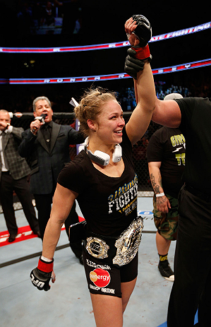 ANAHEIM, CA - FEBRUARY 23:  Ronda Rousey reacts to her victory over Liz Carmouche in their women's bantamweight title fight during UFC 157 at Honda Center on February 23, 2013 in Anaheim, California.  (Photo by Josh Hedges/Zuffa LLC/Zuffa LLC via Getty Images) *** Local Caption *** Ronda Rousey; Liz Carmouche