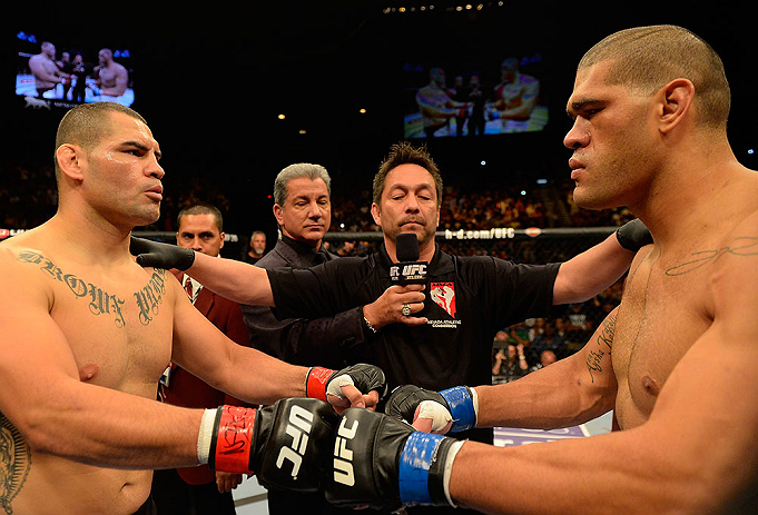 LAS VEGAS, NV - MAY 25:   (L-R) Cain Velasquez and Antonio Silva touch gloves before their heavyweight championship bout during UFC 160 at the MGM Grand Garden Arena on May 25, 2013 in Las Vegas, Nevada.  (Photo by Donald Miralle/Zuffa LLC/Zuffa LLC via Getty Images)  *** Local Caption *** Cain Velasquez; Antonio Silva