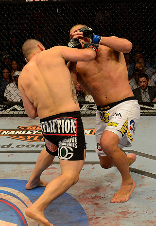 LAS VEGAS, NV - MAY 25:   (L-R) Cain Velasquez punches Antonio Silva in their heavyweight championship bout during UFC 160 at the MGM Grand Garden Arena on May 25, 2013 in Las Vegas, Nevada.  (Photo by Donald Miralle/Zuffa LLC/Zuffa LLC via Getty Images)  *** Local Caption *** Cain Velasquez; Antonio Silva