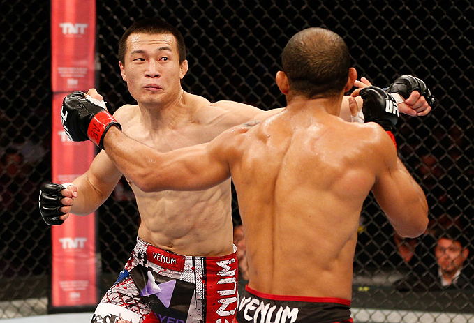 """RIO DE JANEIRO, BRAZIL - AUGUST 03:  (L-R) """"The Korean Zombie"""" Chan Sung Jung and Jose Aldo exchange punches in their featherweight championship bout during UFC 163 at HSBC Arena on August 3, 2013 in Rio de Janeiro, Brazil. (Photo by Josh Hedges/Zuffa LLC/Zuffa LLC via Getty Images)"""