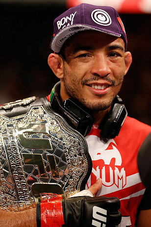 """RIO DE JANEIRO, BRAZIL - AUGUST 03:  Jose Aldo reacts after his victory over """"The Korean Zombie"""" Chan Sung Jung in their featherweight championship bout during UFC 163 at HSBC Arena on August 3, 2013 in Rio de Janeiro, Brazil. (Photo by Josh Hedges/Zuffa LLC/Zuffa LLC via Getty Images)"""