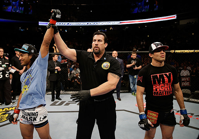 SAN JOSE, CA - APRIL 20:   Benson Henderson (left) is declared the winner over Gilbert Melendez (right) in their lightweight championship bout during the UFC on FOX event at the HP Pavilion on April 20, 2013 in San Jose, California.  (Photo by Ezra Shaw/Zuffa LLC/Zuffa LLC via Getty Images)  *** Local Caption *** Benson Henderson; Gilbert Melendez