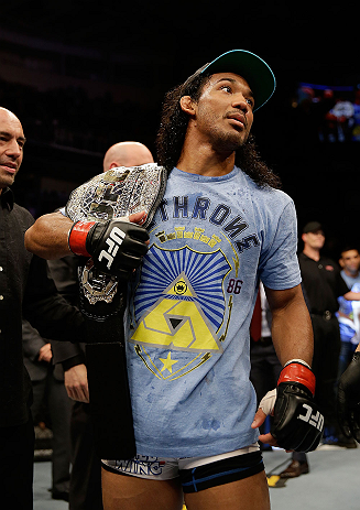 SAN JOSE, CA - APRIL 20:   Benson Henderson is presented with the UFC lightweight championship after his bout with Gilbert Melendez during the UFC on FOX event at the HP Pavilion on April 20, 2013 in San Jose, California.  (Photo by Ezra Shaw/Zuffa LLC/Zuffa LLC via Getty Images)  *** Local Caption *** Benson Henderson; Gilbert Melendez
