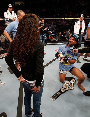 SAN JOSE, CA - APRIL 20:   Benson Henderson (right) proposes to his girlfriend Maria Magana (left) during the UFC on FOX event during the UFC on FOX event at the HP Pavilion on April 20, 2013 in San Jose, California.  (Photo by Josh Hedges/Zuffa LLC/Zuffa LLC via Getty Images)  *** Local Caption *** Benson Henderson; Maria Magana
