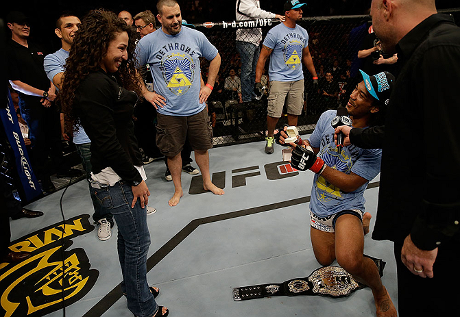 SAN JOSE, CA - APRIL 20:   Benson Henderson (right) proposes to his girlfirend Maria Magana (left) during the UFC on FOX event at the HP Pavilion on April 20, 2013 in San Jose, California.  (Photo by Ezra Shaw/Zuffa LLC/Zuffa LLC via Getty Images)  *** Local Caption *** Benson Henderson; Maria Magana