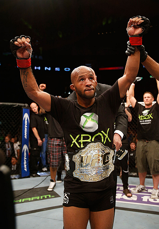 SEATTLE, WA - JULY 27: Demetrious Johnson reacts to his victory over John Moraga in their flyweight championship bout during the UFC on FOX event at Key Arena on July 27, 2013 in Seattle, Washington. (Photo by Josh Hedges/Zuffa LLC/Zuffa LLC via Getty Images) *** Local Caption *** Demetrious Johnson
