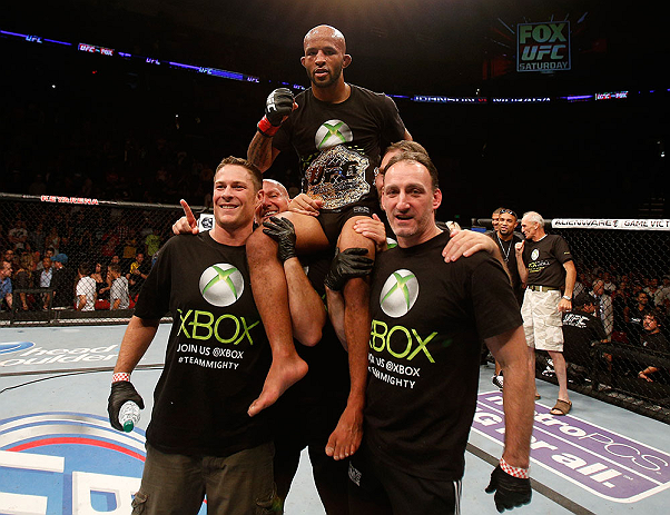 SEATTLE, WA - JULY 27: Demetrious Johnson (top) celebrates to his victory over John Moraga in their flyweight championship bout during the UFC on FOX event at Key Arena on July 27, 2013 in Seattle, Washington. (Photo by Josh Hedges/Zuffa LLC/Zuffa LLC via Getty Images) *** Local Caption *** Demetrious Johnson