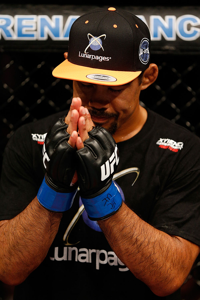MANCHESTER, ENGLAND - OCTOBER 26:  Mark Munoz shows respect to opponent Lyoto Machida after his knockout loss to Machida in their middleweight bout during the UFC Fight Night event at Phones 4 U Arena on October 26, 2013 in Manchester, England. (Photo by Josh Hedges/Zuffa LLC/Zuffa LLC via Getty Images)