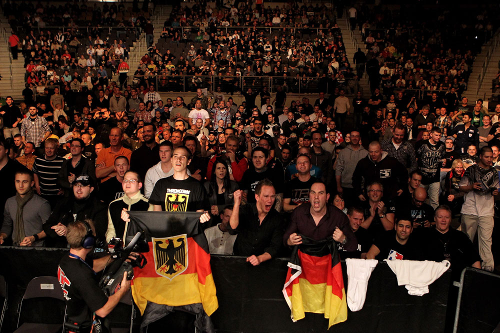 Fans show their support as Pascal Krauss of Germany fights Marc Scanlon of the United Kingdom during their UFC Welterweight bout at the Konig Pilsner Arena on November 13, 2010 in Oberhausen, Germany. (Photo by Josh Hedges/Zuffa LLC/Zuffa LLC via Getty Images)