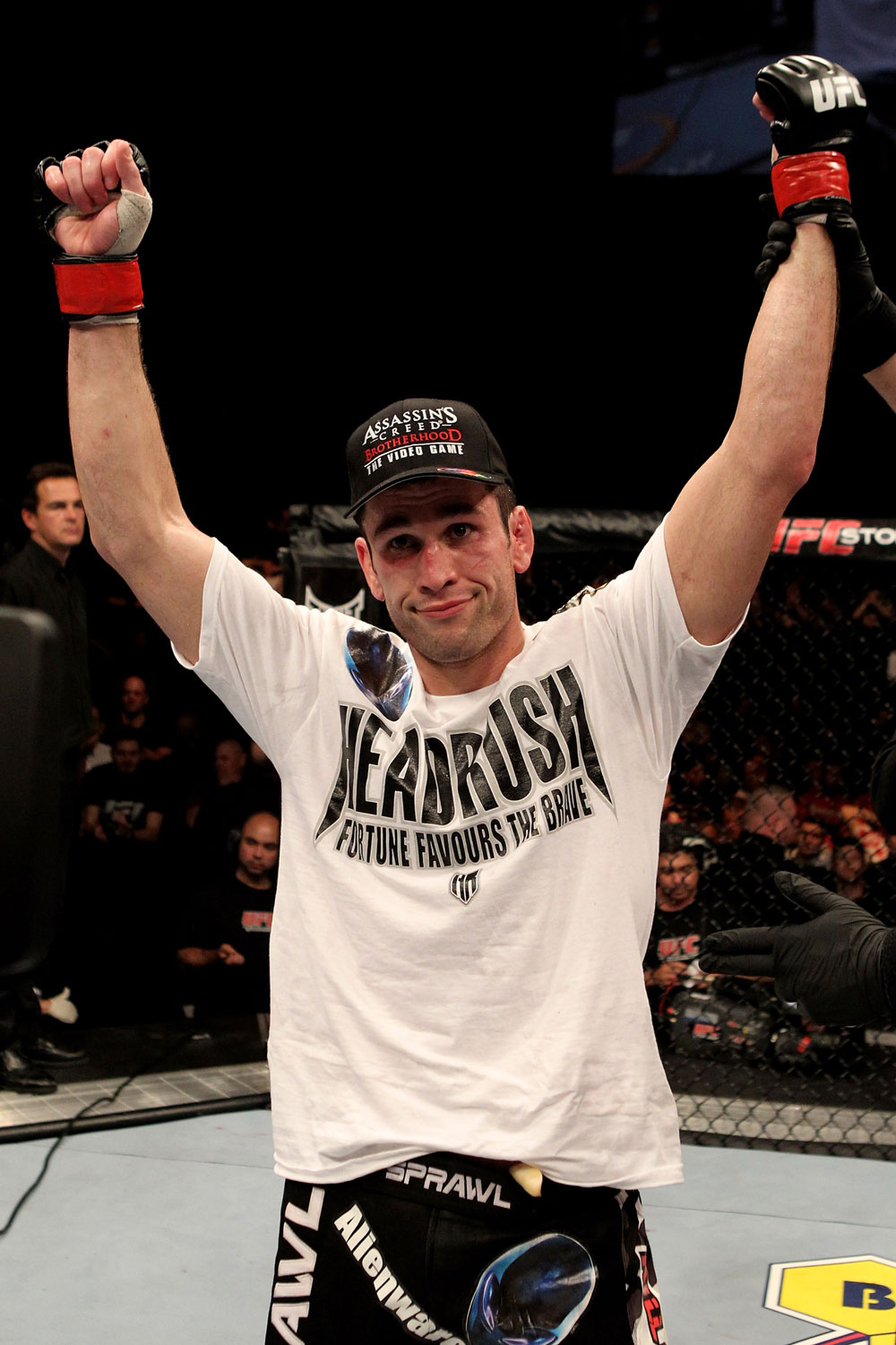 Amir Sadollah of the USA celebrates his unanimous points victory over Peter Sobatta of Germany during their UFC Welterweight bout at the Konig Pilsner Arena on November 13, 2010 in Oberhausen, Germany. (Photo by Josh Hedges/Zuffa LLC/Zuffa LLC)