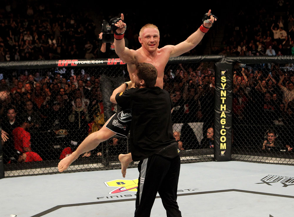 Dennis Siver of Germany celebrates his victory by tap out in the 1st round over Andre Winner of England during their UFC Lightweight bout at the Konig Pilsner Arena on November 13, 2010 in Oberhausen, Germany. (Photo by Josh Hedges/Zuffa LLC/Zuffa LLC)