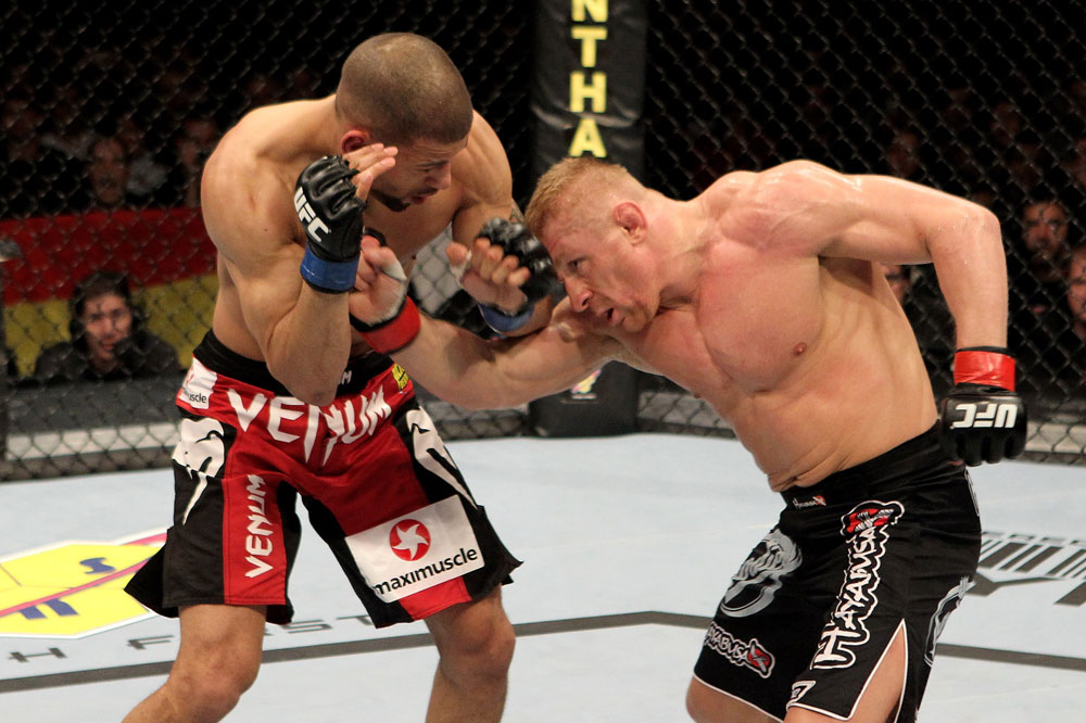 Dennis Siver (R) of Germany fights Andre Winner of England during their UFC Lightweight bout at the Konig Pilsner Arena on November 13, 2010 in Oberhausen, Germany. (Photo by Josh Hedges/Zuffa LLC/Zuffa LLC)