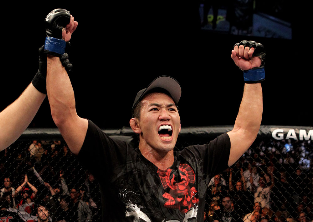 Yushin Okami of Japan celebrates his unanimous points victory over Nate Marquardt of the USA during their UFC Middleweight Championship Eliminator bout at the Konig Pilsner Arena on November 13, 2010 in Oberhausen, Germany. (Photo by Josh Hedges/Zuffa LLC/Zuffa LLC)