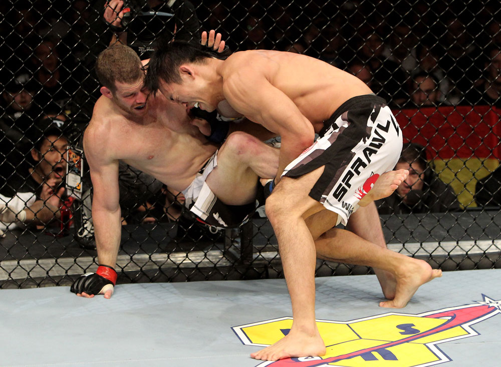 Nate Marquardt of the USA fights Yushin Okami (R) of Japan during their UFC Middleweight Championship Eliminator bout at the Konig Pilsner Arena on November 13, 2010 in Oberhausen, Germany. (Photo by Josh Hedges/Zuffa LLC/Zuffa LLC via Getty Images)