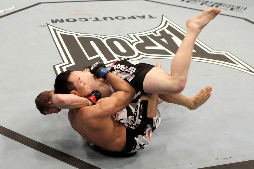 Nate Marquardt of the USA fights Yushin Okami (L) of Japan during their UFC Middleweight Championship Eliminator bout at the Konig Pilsner Arena on November 13, 2010 in Oberhausen, Germany. (Photo by Josh Hedges/Zuffa LLC/Zuffa LLC)
