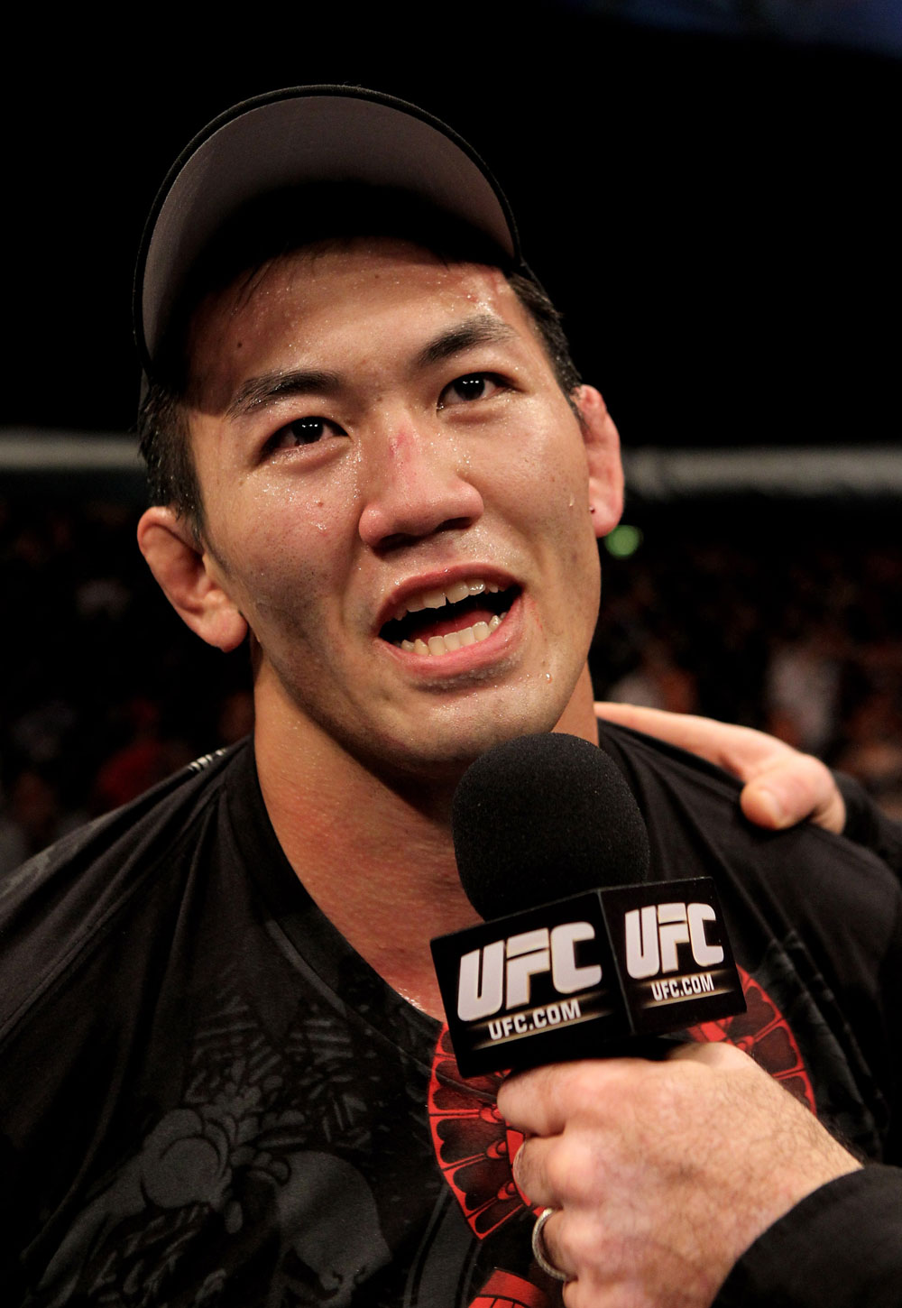 Yushin Okami of Japan is interviewd after his unanimous points victory over Nate Marquardt of the USA during their UFC Middleweight Championship Eliminator bout at the Konig Pilsner Arena on November 13, 2010 in Oberhausen, Germany. (Photo by Josh Hedges/Zuffa LLC/Zuffa LLC)