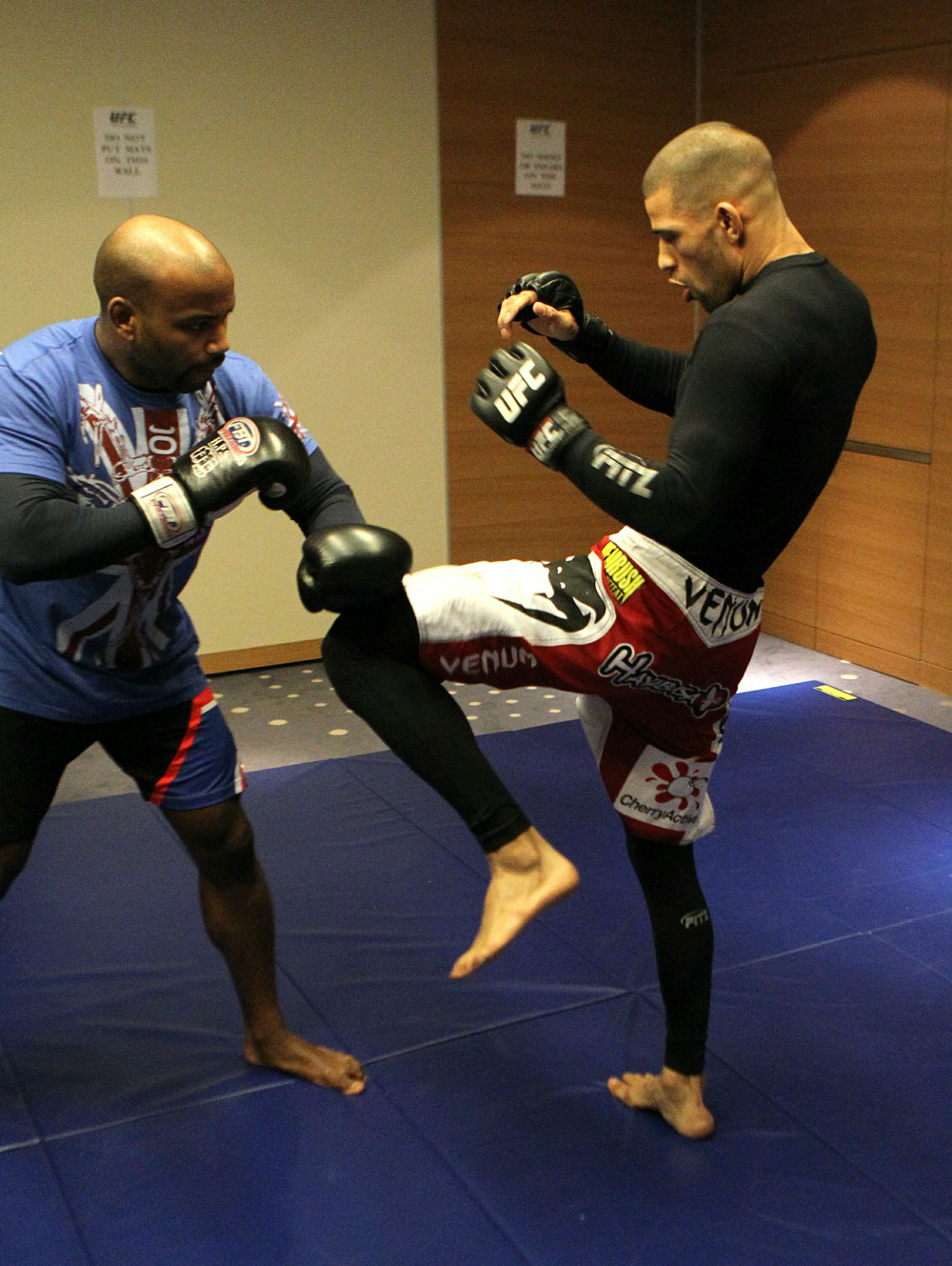 Andre Winner (R) works out with trainer Dean Amasinger at the UFC 122 open workouts at the Hilton Hotel on November 10,  2010 in Dusseldorf, Germany.  (Photo by Josh Hedges/Zuffa LLC via Getty Images)