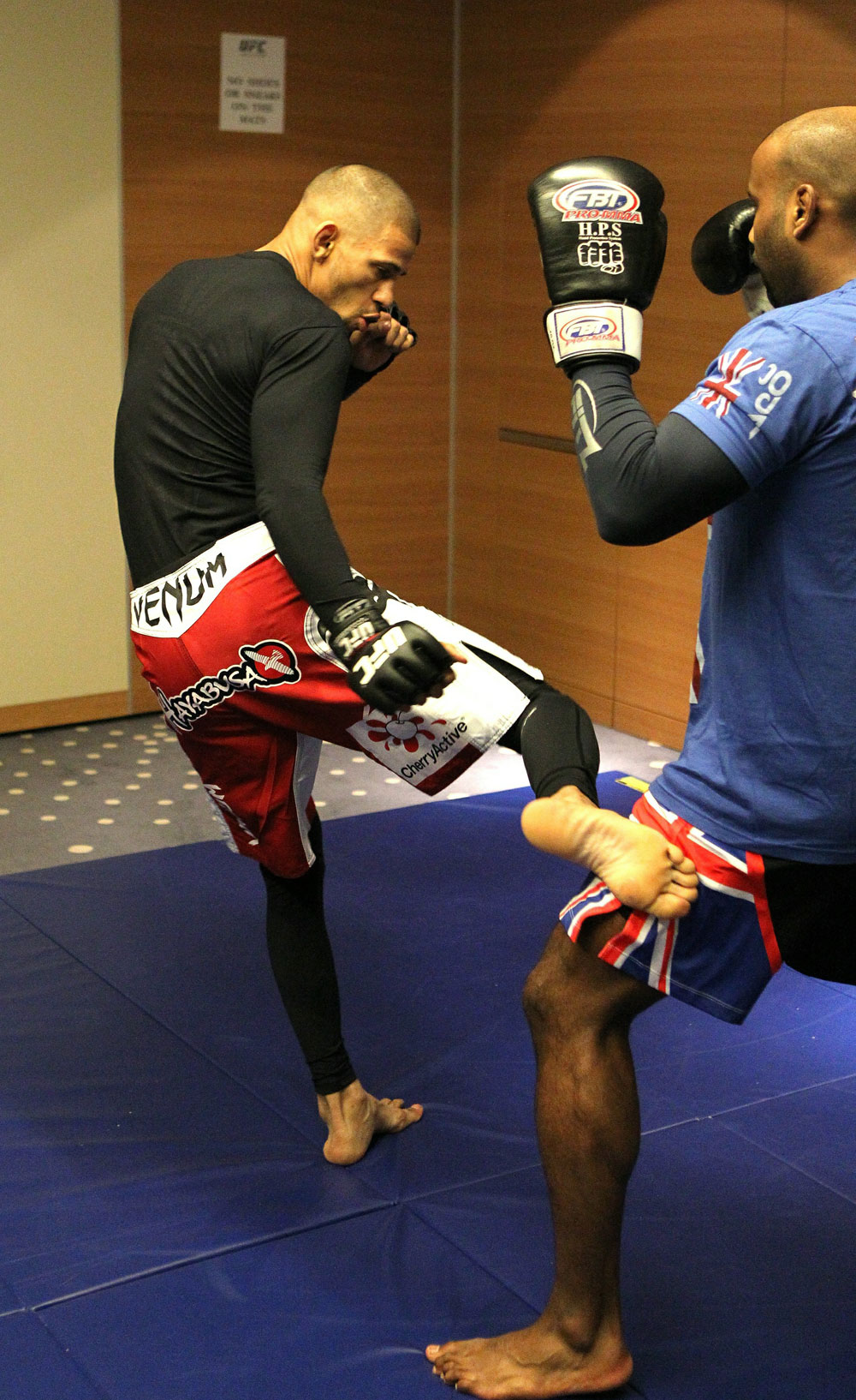 Andre Winner works out with trainer Dean Amasinger at the UFC 122 open workouts at the Hilton Hotel on November 10,  2010 in Dusseldorf, Germany.  (Photo by Josh Hedges/Zuffa LLC via Getty Images)