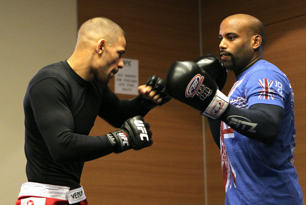 Andre Winner (L) works out with trainer Dean Amasinger at the UFC 122 open workouts at the Hilton Hotel on November 10,  2010 in Dusseldorf, Germany.  (Photo by Josh Hedges/Zuffa LLC via Getty Images)