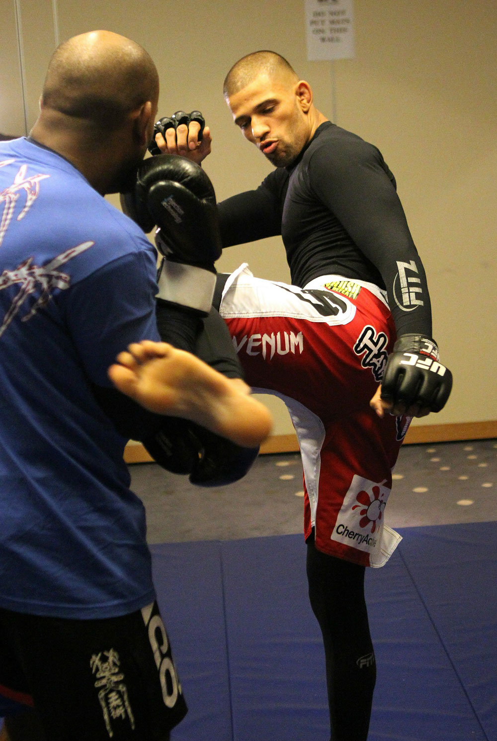 (R-L) Andre Winner works out with trainer Dean Amasinger at the UFC 122 open workouts at the Hilton Hotel on November 10,  2010 in Dusseldorf, Germany.  (Photo by Josh Hedges/Zuffa LLC via Getty Images)
