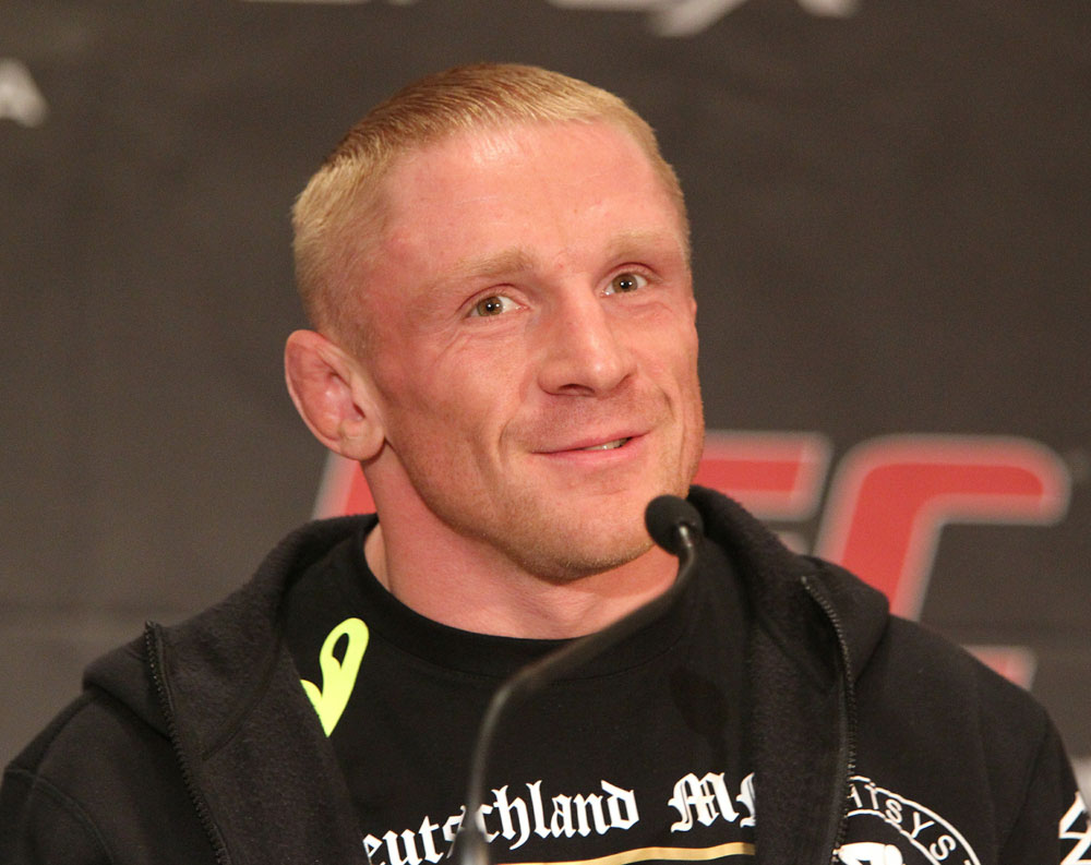 Dennis Siver of Germany speaks at the UFC 122 pre-fight press conference at the Hilton Hotel on November 11,  2010 in Dusseldorf, Germany.  (Photo by Josh Hedges/Zuffa LLC/Zuffa LLC via Getty Images)