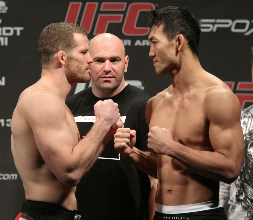 Middleweight opponents Nate Marquardt (L) of United States and Yushin Okami (R) of Japan face off as UFC Presdient Dana White looks on at the UFC 122 weigh-in at the Koenig Pilsener Arena on November 12,  2010 in Oberhausen, Germany.  (Photo by Josh Hedges/Zuffa LLC/Zuffa LL
