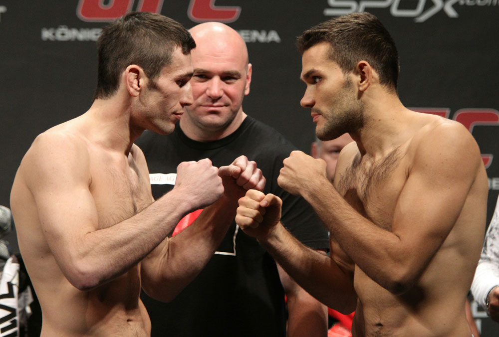 Welterweight opponents Amir Sadollah (L) of United States and Peter Sobotta (R) of Poland face off as UFC President Dana White looks on at the UFC 122 weigh-in at the Koenig Pilsener Arena on November 12,  2010 in Oberhausen, Germany.  (Photo by Josh Hedges/Zuffa LLC/Zuffa L