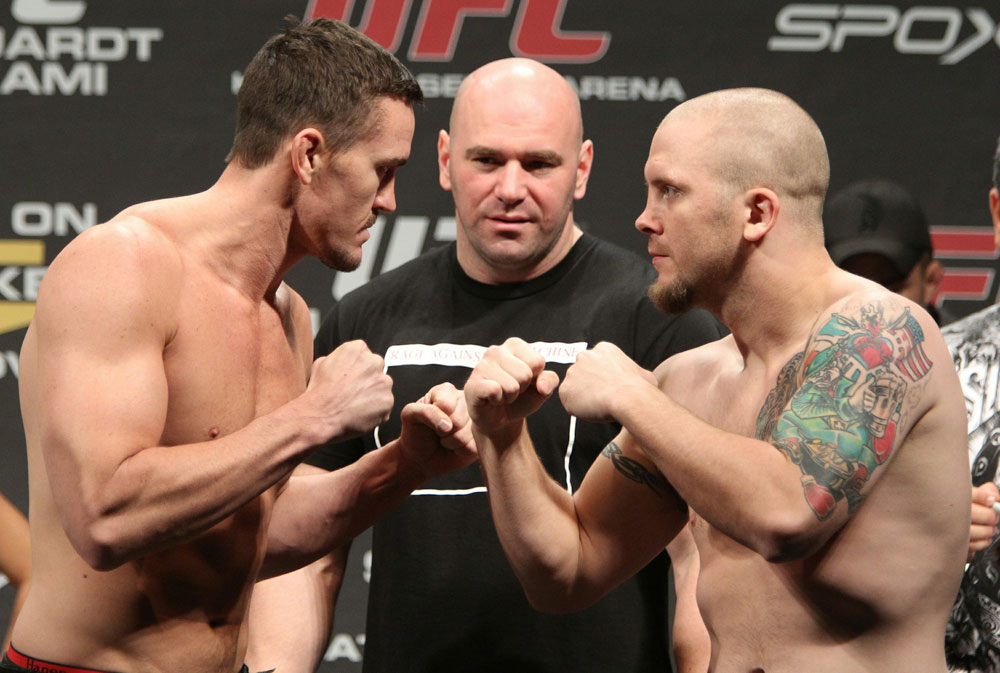 Middleweight opponents Kyle Noke (L) and Rob Kimmons (R) face off as UFC President Dana White looks on at the UFC 122 weigh-in at the K&scaron;nig Pilsener Arena on November 12,  2010 in Oberhausen, Germany.  (Photo by Josh Hedges/Zuffa LLC/Zuffa LLC via Getty Images)
