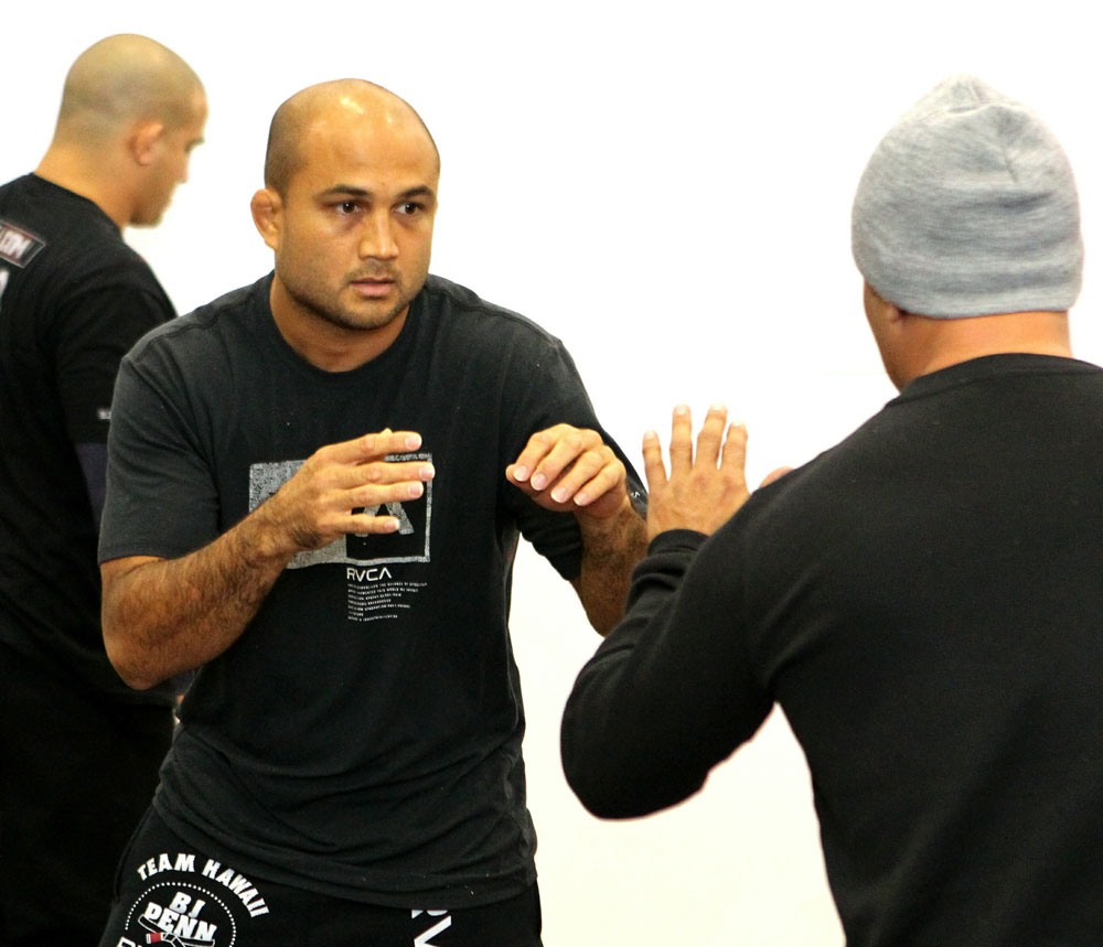 BJ Penn (L) works out for the media at the UFC 123 open workouts at the Detroit Athletic Club on November 18, 2010 in Detroit, Michigan.  (Photo by Josh Hedges/Zuffa LLC/Zuffa LLC via Getty Images)
