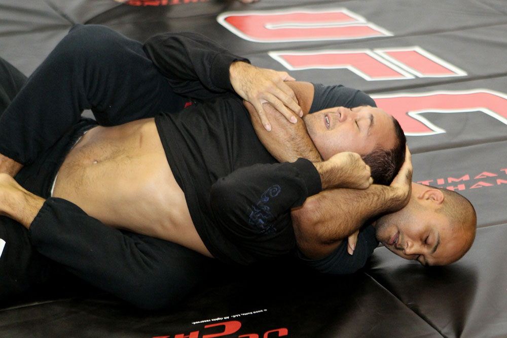 BJ Penn (R) works out for the media at the UFC 123 open workouts at the Detroit Athletic Club on November 18, 2010 in Detroit, Michigan.  (Photo by Josh Hedges/Zuffa LLC/Zuffa LLC via Getty Images)