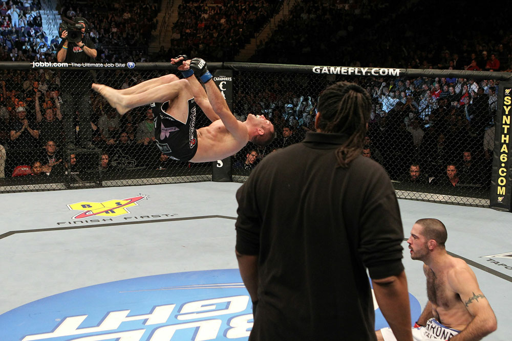 UFC 123: Brian Foster celebrates with a backflip.