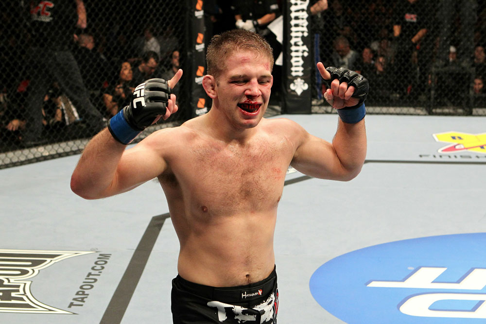 Nik Lentz celebrates his win over Tyson Griffin during UFC123.
