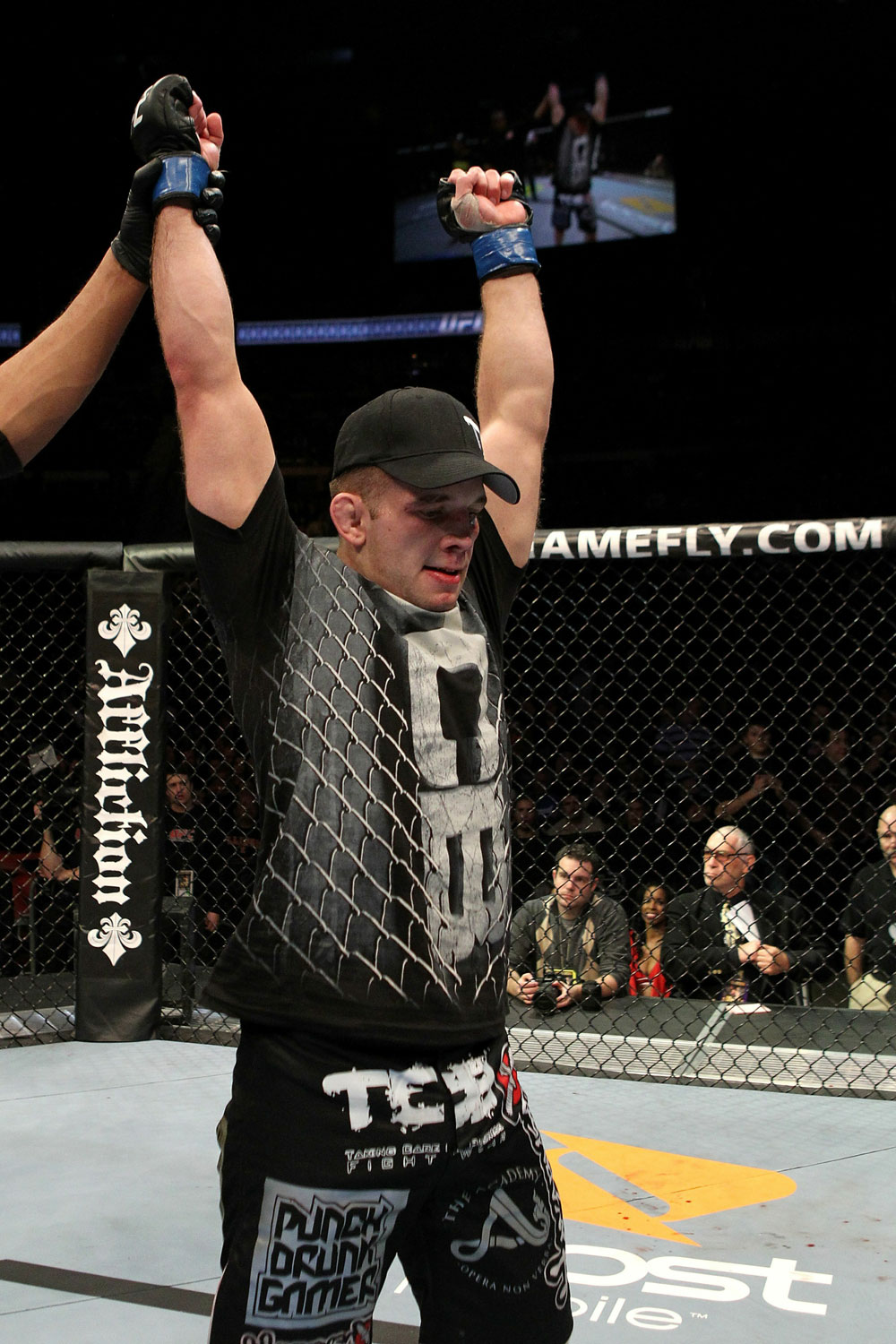 Nik Lentz celebrates after winning UFC 123 over Tyson Griffin.