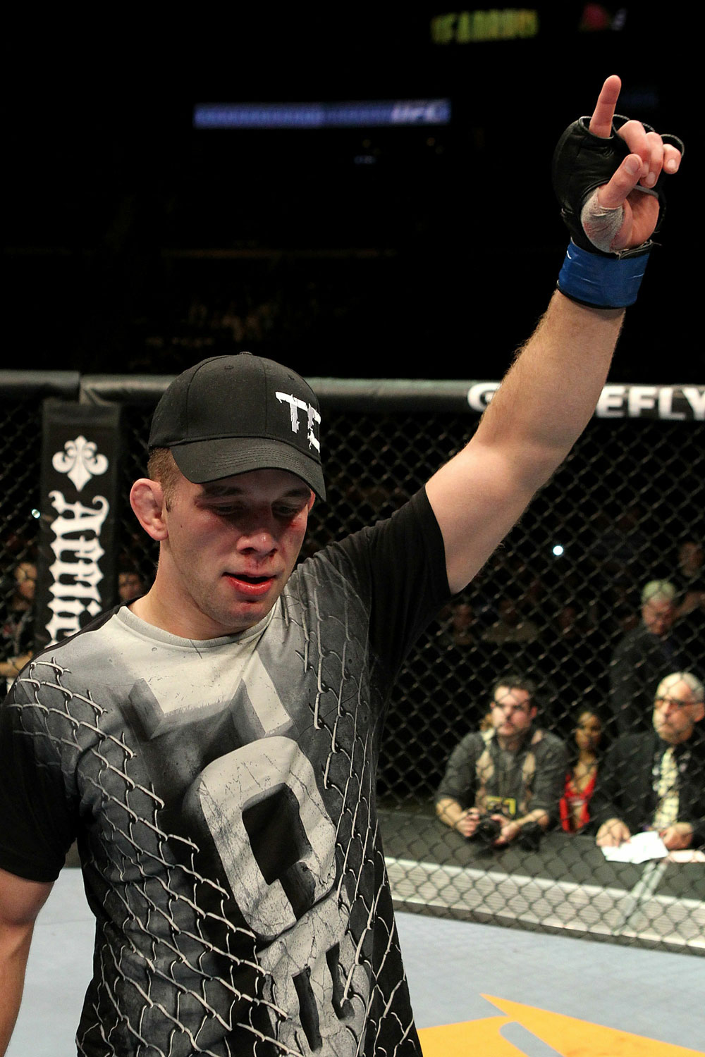 Nik Lentz celebrates after beating Tyson Griffin at UFC 123.