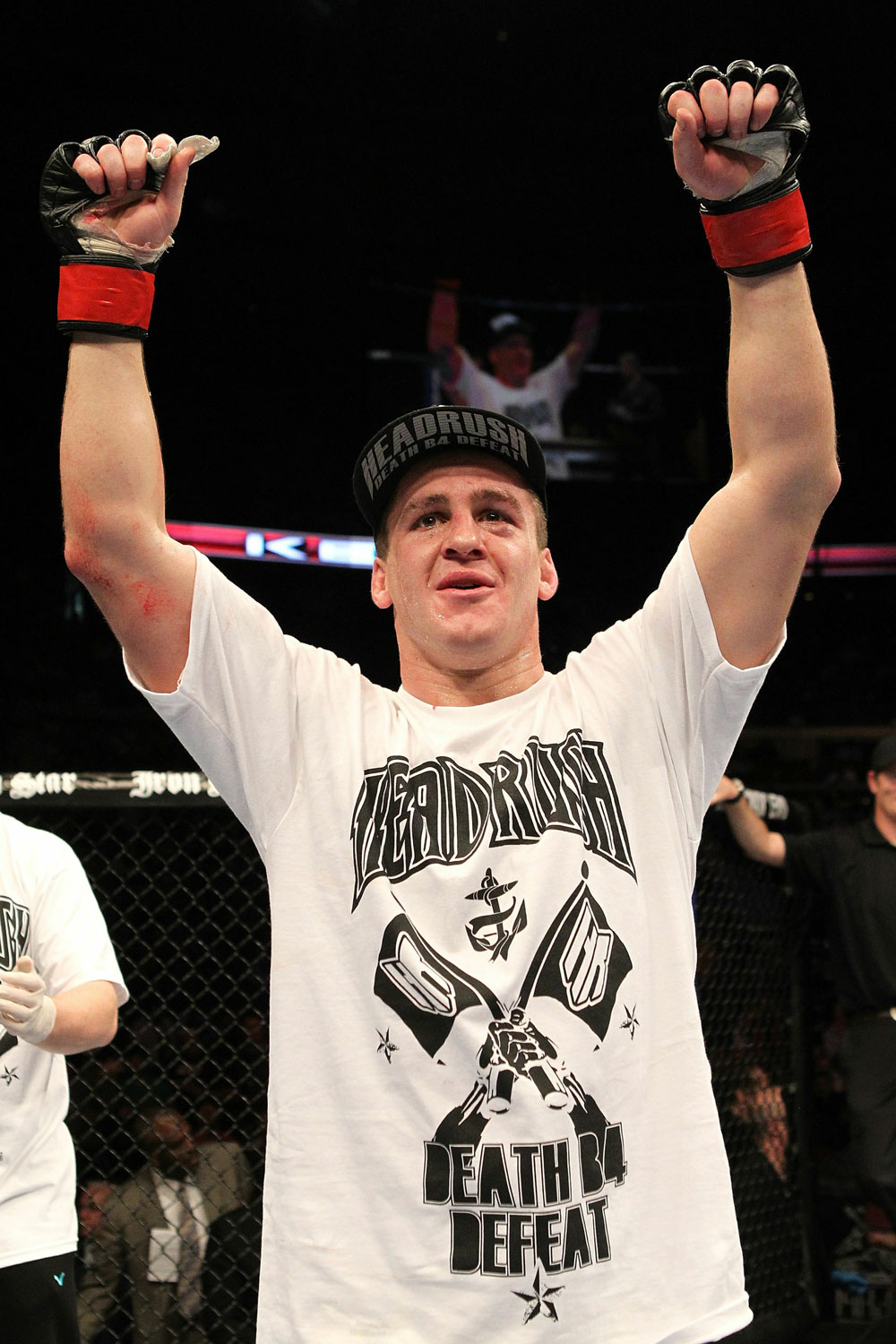 Paul Kelly celebrates his win over TJ O&#39;Brien during UFC 123